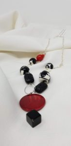 Long black white red necklace