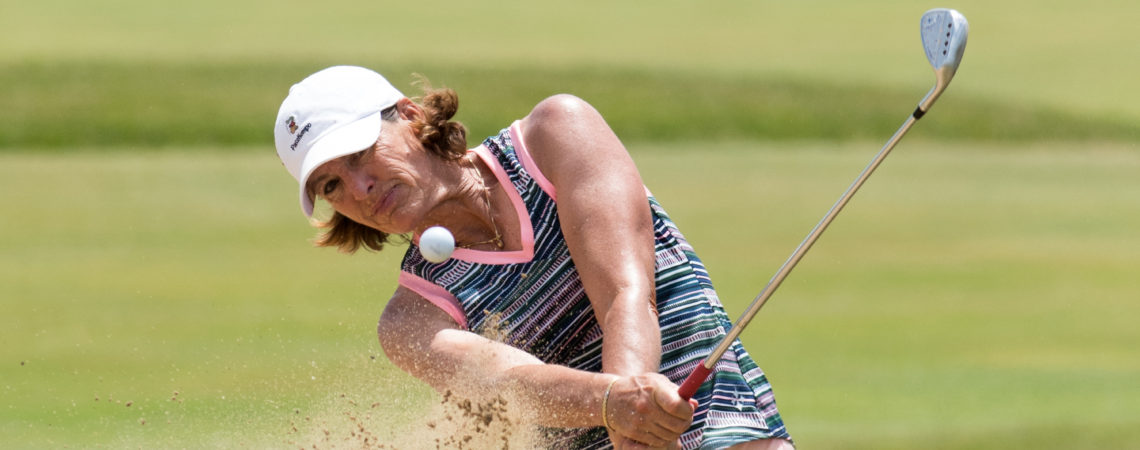 Juli Inkster gets out of the sand trap in the back half of the inaugural U.S. Senior Women's Open Championship held at Chicago Golf Club in Wheaton July 15.